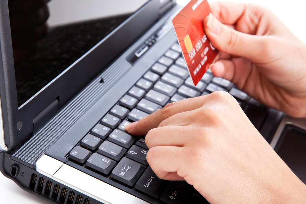 Credit card in hand for buying online