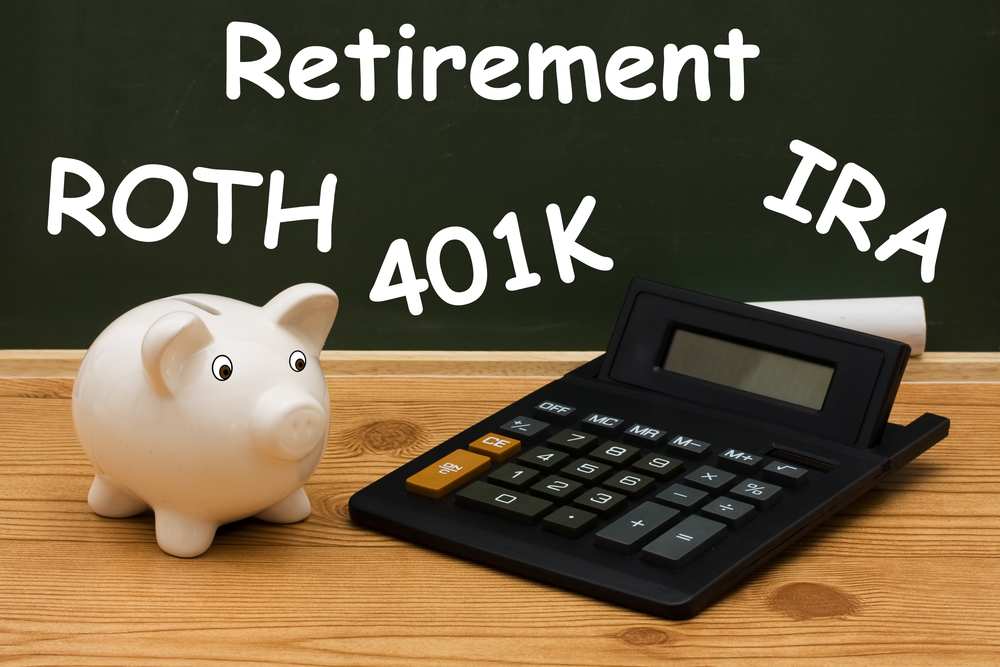 A piggy bank with calculator and chalk on a chalkboard with word retirement, Understanding your retirement